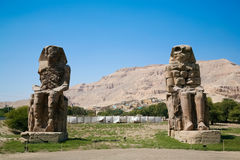 The Colossi of Memnon. Giant double statue of landmark Egyptian pharaoh Amenhotep III named The Colossi de Memnon, public sculpture monument in Luxor, Egypt Stock Image