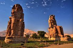 The Colossi of Memnon. Luxor, Egypt. The Colossi of Memnon (1350 BC). Luxor, Egypt Royalty Free Stock Images