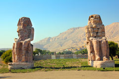 Colossi of memnon in Luxor Egypt. Colossi of memnon gigantic statues in Luxor Egypt Royalty Free Stock Photography