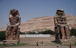 Colossi of Memnon. Luxor. Egypt. The Colossi of Memnon are two massive stone statues of Pharaoh Amenhotep III. They stand in the Theban necropolis, west of the royalty free stock images