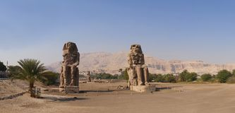 Colossi of Memnon, Luxor, stone sculptures. Panorama of Colossi of Memnon, Luxor, Thebes Egypt Africa stone sculptures Royalty Free Stock Photos