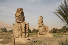 The Colossi of Memnon. Situated on the west bank of the Nile close to Luxor, these huge statues are all that remains of a massive temple Royalty Free Stock Photo