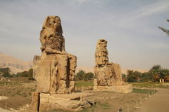 The Colossi of Memnon. Situated on the west bank of the Nile close to Luxor, these huge statues are all that remains of a massive temple Stock Images