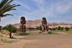 The Colossi of Memnon. Two massive stone statues of Pharaoh Amenhotep III in Luxor Egypt Stock Photos
