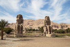 Colossi of Memnon. The Colossi of Memnon are two massive stone statues of the Pharaoh Amenhotep III, lUXOR, eGYPT Royalty Free Stock Photos