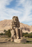 Colossi of Memnon. The Colossi of Memnon are two massive stone statues of the Pharaoh Amenhotep III, lUXOR, eGYPT Stock Photography