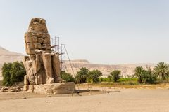 Ancient statues of Colossi on the west bank of the Nile, Luxor, Egypt. The Colossi of Memnon are two massive stone statues of the Pharaoh Amenhotep III, who stock images