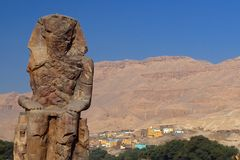 Colossus of Memnon. Left hand Statue of Memnon, on the road leading into the Valley of the Kings, across the Nile from Luxor, Egypt Royalty Free Stock Photo