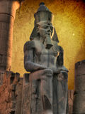 Colossus of Ramses II in the Luxor Temple (Egypt). Colossus of Ramses II (made in black granite) in the Luxor Temple (Egypt royalty free stock photos