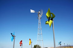 Colouful windmills. With blue sky as background Stock Photography