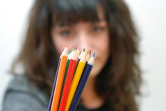 Colour. Women with pencils out of focus Stock Images