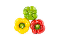 Colour bell peppers. Isolated on over white background Stock Images
