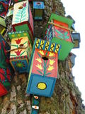 Colour bird houses. Bird houses with national ornaments Royalty Free Stock Image