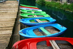 Colour boats at landing stage ashore Stock Photo