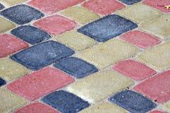 Colour bricks on a path for a background. Stock Photos
