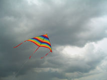 Colour bright flying kite against the storm sky Royalty Free Stock Image