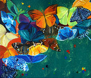 Colour butterflies on a gree background Royalty Free Stock Images