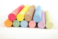 Colour chalk isolated on white Stock Images