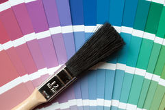 Colour charts. A paint brush lying on colour charts Royalty Free Stock Photos
