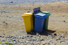 Colour coded rubbishe bins for re-cycling waste on a sunny beach in Teneriffe in Playa Las Americas in the Spanish Canary islands Stock Image