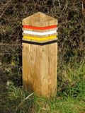 Colour Coded Wooden Post on the South West Coast Path, UK royalty free stock photo