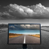 Colour concept with TV screen on open road. Modern LCD monitor on straight empty asphalt road. Color concept Royalty Free Stock Image