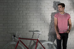 Colour-coordinated with his bicycle Royalty Free Stock Images
