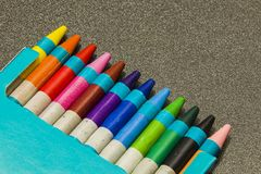 Colour crayons on a dark grey background. Twelve different Colour crayons on a dark grey background Stock Photo
