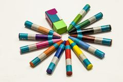 Colour crayons on white background. Twelve different Colour crayons and eraser on white background Royalty Free Stock Images