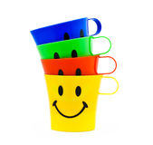 Colour cups with drawing Royalty Free Stock Photos