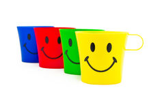 Colour cups with drawing in a kind of smile Royalty Free Stock Photography