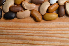 Colour dry beans mix on desk Stock Photography