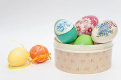 Colour eggs have dropped out of a casket Royalty Free Stock Images