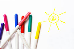 Colour felt-tip pens and sun Royalty Free Stock Photo