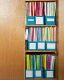 Colour file folders in office cupboard Royalty Free Stock Images