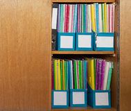 Colour file folders in office cupboard Royalty Free Stock Image