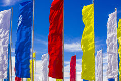 Colour flags. Against the sky Royalty Free Stock Photography