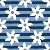 Colour floral seamless pattern. White flowers on uneven striped blue background. Stock Image