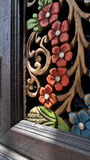 Colour flower wood carving on teak wood cabinet Royalty Free Stock Photo