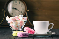 Colour french cookies on dark rustic wooden table stock images