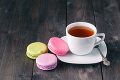 Colour french cookies on dark rustic wooden table stock photo