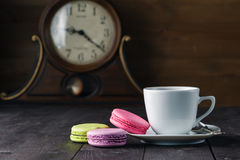 Colour french cookies on dark rustic wooden table Royalty Free Stock Photos
