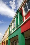 Colour homes above shops Royalty Free Stock Photo