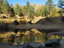 Colour lake in forest at autumn stock images