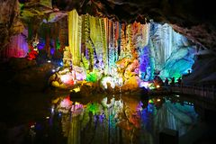 Colour Light Illuminated Cave Landscape, with mirror reflection. Silver Cave, Guilin, China. Colour Light Illuminated Cave Landscape, Silver Cave, Guilin, China royalty free stock image