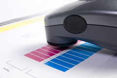 Colour Management. Spectrophotometer and calibration chart Royalty Free Stock Photos