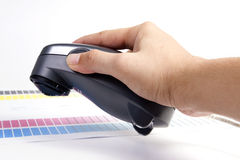 Colour Management. Spectrophotometer and calibration chart stock images