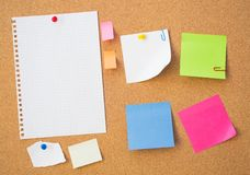 Colour note papers on pin board. Royalty Free Stock Photography