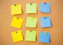 Colour note papers on pin board stock images