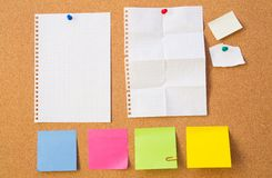 Colour note papers on pin board. Stock Images